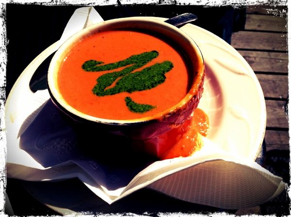 Tomato soup with a squiggle of pesto on top