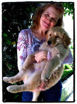 Me holding Daisy the Golden retriever at 12 weeks
