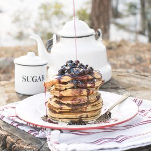 Iron Man Protein Pancakes with blueberry syrup from The Camp & Cabin Cookbook by Laura Bashar