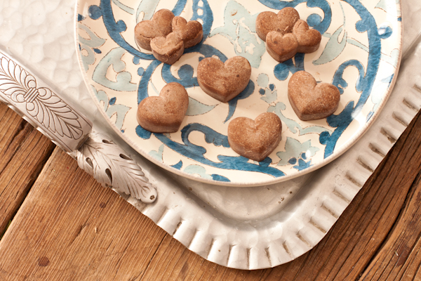 Sweet sun-carob hearts on a blue and white plate.