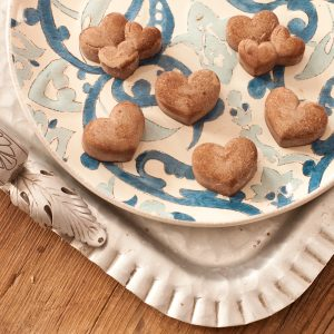 Sweet sun-carob hearts on a blue and white plate
