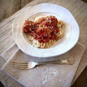 Mama Capra's marinara sauce with meatballs and gluten-free capellini