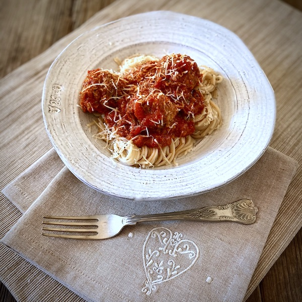 Mama Capra's marinara sauce with meatballs and gluten-free capellini
